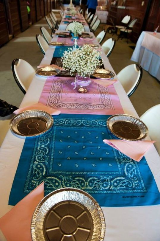 Cowgirl party idea, table decor. Like the mason jars filled with babies breath and wrapped with a bandana.