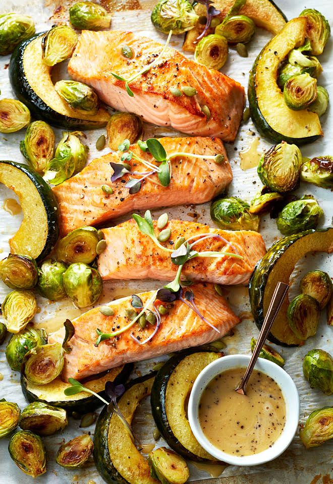 The trick to moist, flavourful baked salmon is to keep the skin on! Serve it with roasted acorn squash and brussels sprouts for an easy weeknight meal.