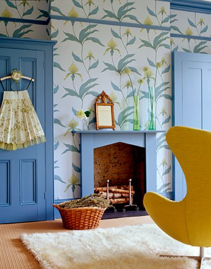 wallpaper + sky blue: this is bold wallpaper well done, the yellow chair is the perfect complement