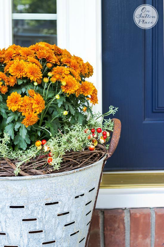Fall Mums in Olive Buckets   Easy, DIY way to add a touch of vintage charm to your Fall porch decor. Includes photos on how to assemble.