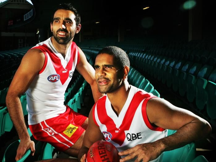 Adam Goodes and Michael O'Loughlin model Sydney's heritage guernsey worn here in 2007.