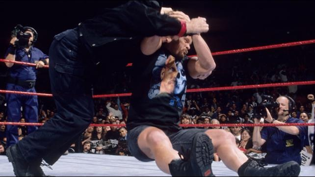 """""""Stone Cold"""" Steve Austin delivering the """"Stone Cold Stunner"""" to Vince McMahon"""