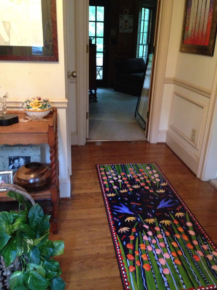 """""""Gladiolas and Bluebird"""" Floorcloth in the hallway."""