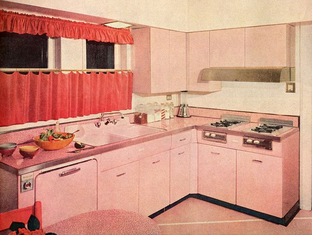 Vintage pink kitchen  look at those wonderful pink cabinets!