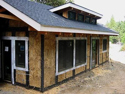 A modern straw bale home before plaster is applied (hmm.. wonder if cheaper than insulation?? We need to insulate more)..