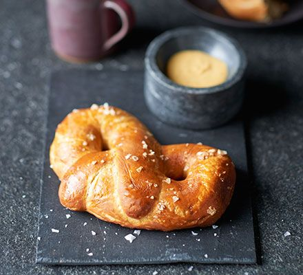 Edd Kimber demonstrates how to make perfect pretzels with a chewy crust and soft, fluffy interior. Mix honey and mustard for a fantastic dip to go with them