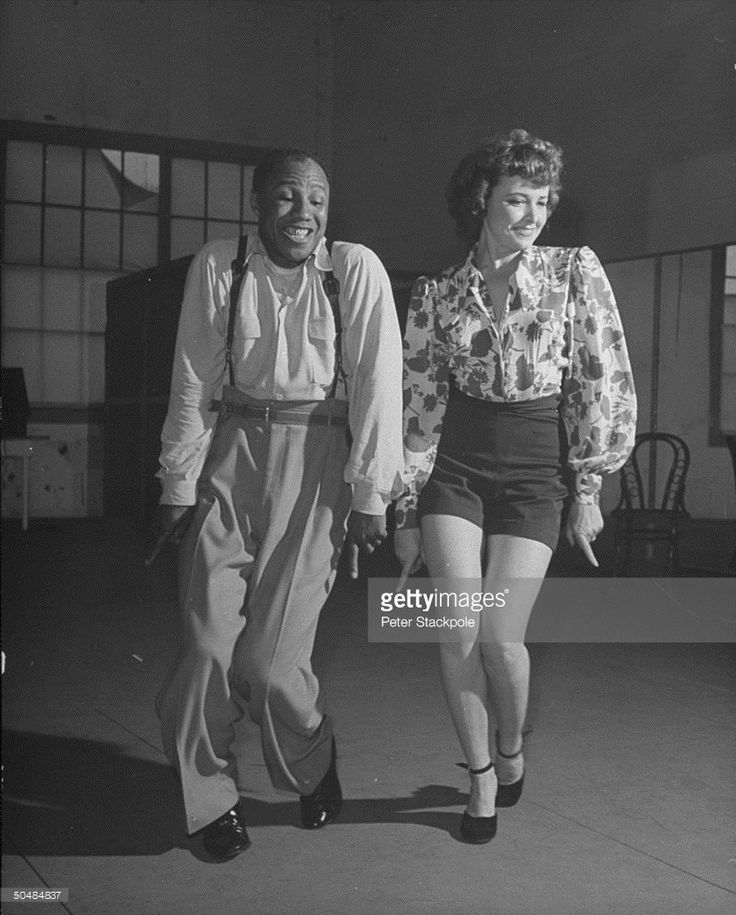 Actress Laraine Day practicing dancing with Robyn.
