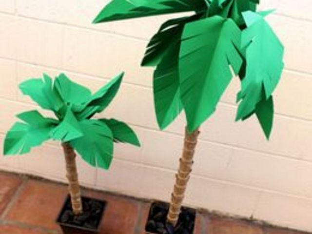Paper palm trees are perfect for decorating a tropical themed party or classroom event. They're fun to make, and a good project for kids to help with, too. You could even make them with a Sunday school class for Palm Sunday. And it's amazing how realistic these palm trees look. You may be tempted to spread out a beach towel and lay under them.