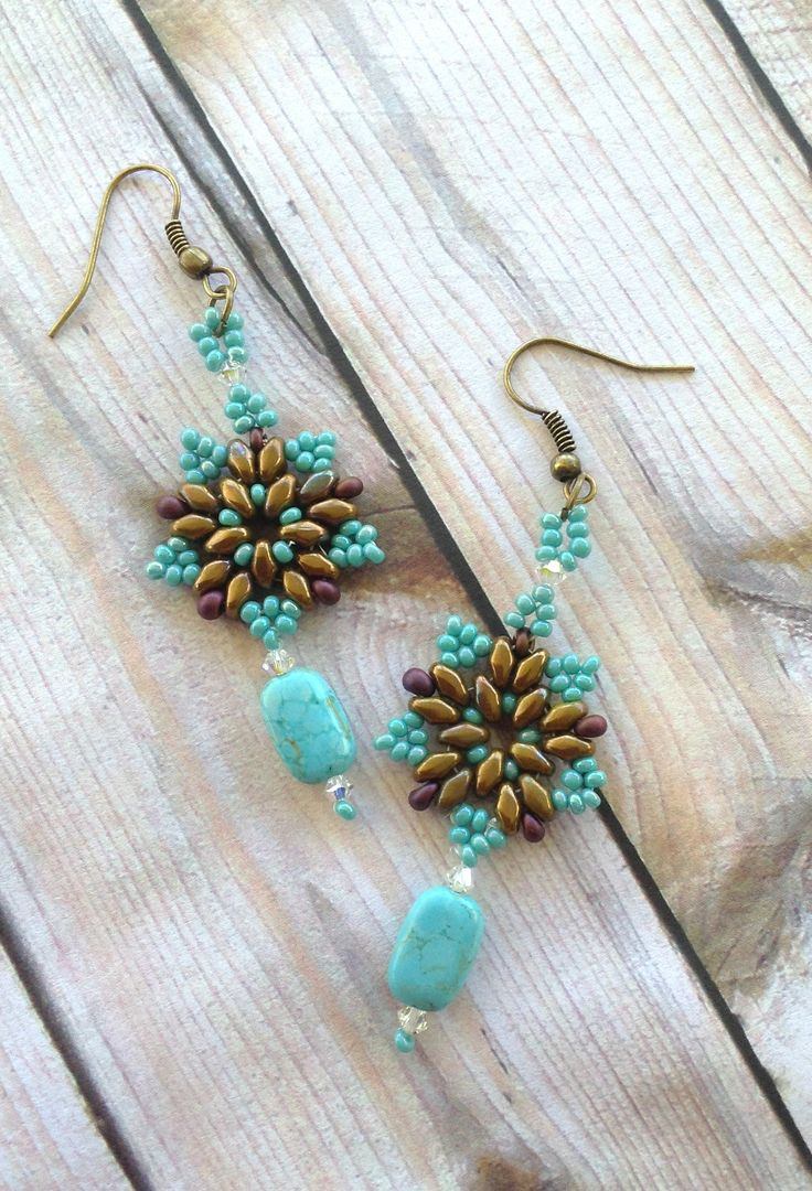 Country Chic Beaded Starburst Earrings made with Super Duo Beads .. Magatama Beads .. Swarovski Bicones .. and seed beads .. Hanging from bottom is a turquoise bead and rhinestones .. Designed by Jann Tague .. Clever Designs .. https://www.facebook.com/#!/JewelsByJann