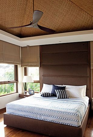 Vivian explains that the look of the master bedroom was inspired by the designs featured in Gelo Manosa's book! We especially love the pitched roof, wooden ceiling fan, and the floor-to-ceiling padded headboard.