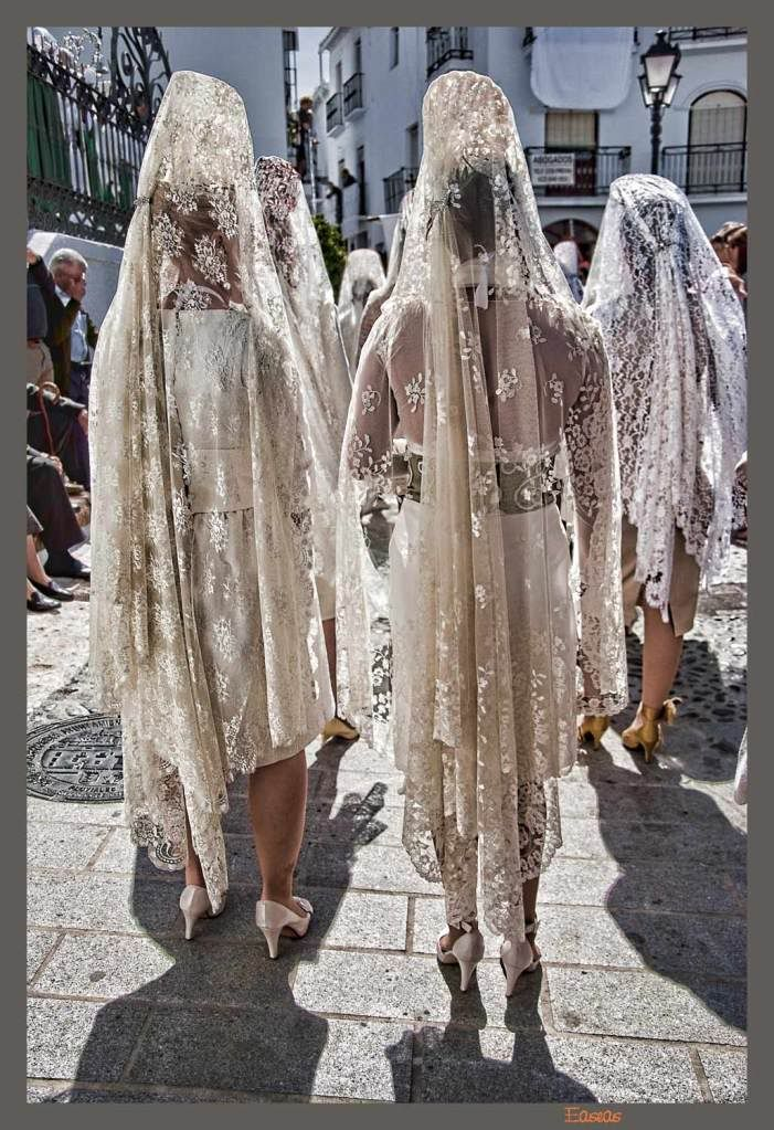 very tipical spanish white mantilla and peineta