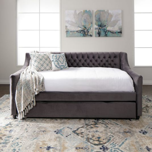 Add extra style and room for guests with the Vivvian charcoal twin daybed with trundle. Covered in a super-soft velvet upholstery with button tufting, the Vivvian is a great addition to an office, youth bedroom or guest room. This versatile 3-in-1 furniture multitasks as a bed, sofa, and guestroo...