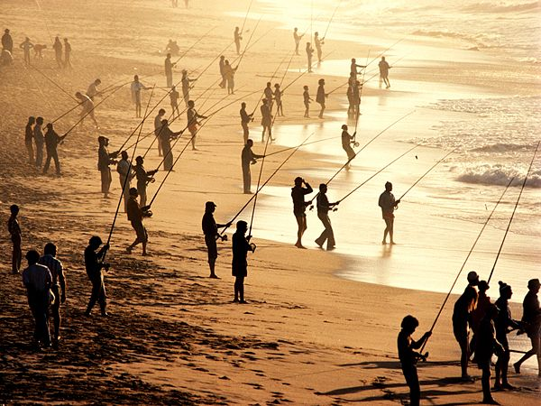 Fishing Photograph by Tony Arruza, Getty Images People fish on a beach near Durban. Recreational fishing is a popular pastime for locals and a draw for visitors.