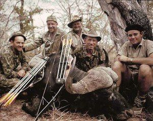 Famed archer Fred Bear (second from right) is shown with Wally Johnson (middle) and Walter Johnson (right) with a Mozambique buffalo that Bear took with a Bear Archery 80-pound recurve bow. Also pictured are Dick Mauch (far left) and Bill Wright (second from left)