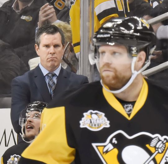 Here you can see Mike Sullivan considering if Phil Kessel's (1) goal is enough to let him live while he murders all of his teammates.    1-10 Pens vs Hawks