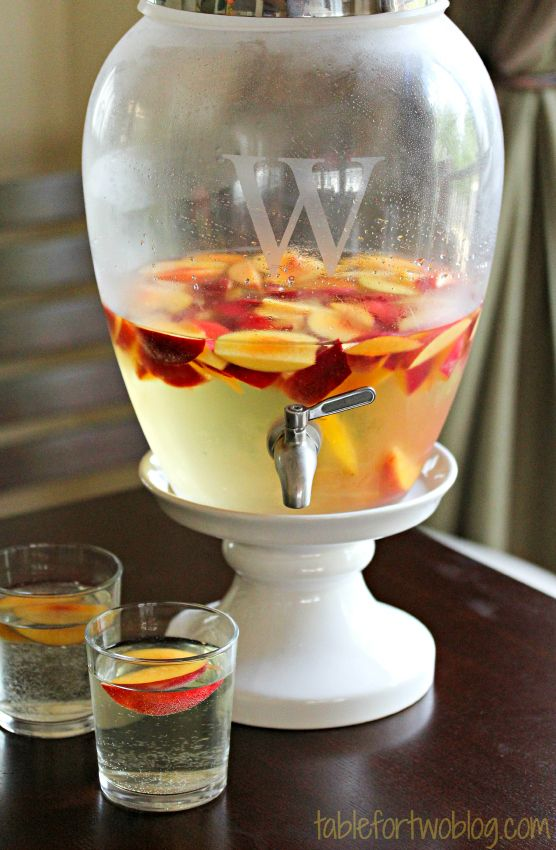 Sparkling Peach Sangria -- 6-8 peaches, sliced, 2 bottles of Riesling, 1 bottle of sparkling wine, 1/2 bottle of peach vodka. Put everything except the prosecco/sparkling wine in a large pitcher and refrigerate overnight. Before sercing pour in the sparkling wine, stir with wooden spoon and serve.:
