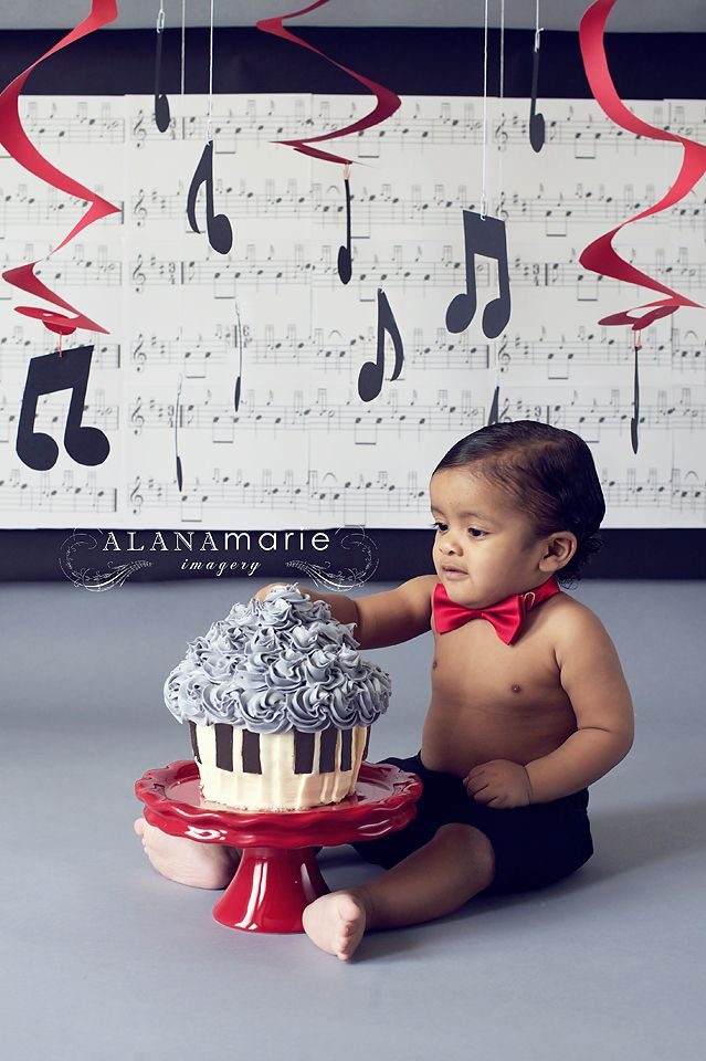 baby boy 1st birthday cake smash session portrait. red & black music theme.  © Alana Marie Imagery www.alanamarieimagery.com www.facebook.com/AlanaMarieImagery
