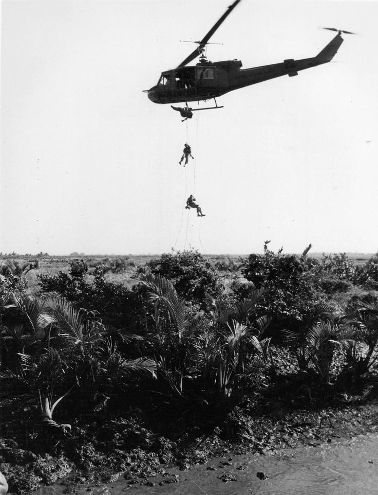 U.S. Navy SEALS repel down ropes from a U.S. Army Bell UH-1B Iroquois helicopter to set an ambush in the jungle below during operations in South Vietnam onMarch 13, 1967.