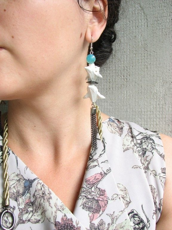 Long earrings made of Trapa Natans seeds, semiprecious stones and metal.  www.iasoltanei.ro