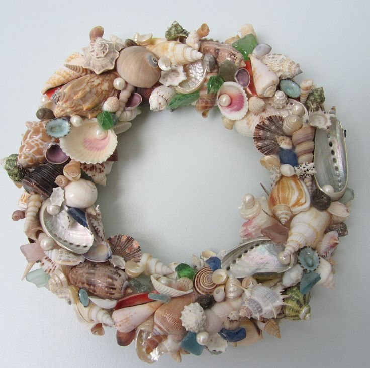 Seashell Wreath for Beach Decor - Nautical Decor Shell Wreath w Sea Glass. $100.00, via Etsy.