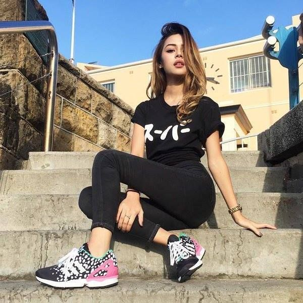 Cute girl in black-----T-shirt, yoga trousers & joggers------buns