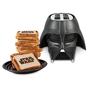 [Dark Toast]Start your day feeling ready to rule the galaxy with the Darth Vader electric toaster. Pop in the bread and in moments, the <i>Star Wars</i> logo is toasted right on it. Like your toast on the darker side? A handy dial turns up the heat.