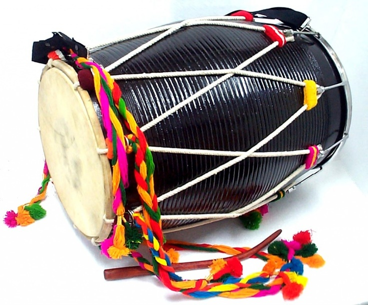 This is the punjabi instrument called a tol. This is used lots in bhangra preformances and somtimes the person playing it is in the middle of a circle that the preformer's have made.