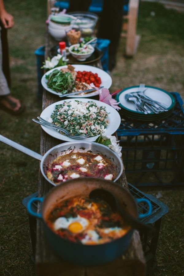 Food looks amazing, especially the pot on the end with eggs in it, but I think the essential vegetarian ingredient in this feast is the wooden log used to display the dishes. ;)