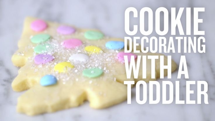 As much as you'd like to create picture-perfect holiday cookies that impress friends and family, what's really important is that they bring some joy. And what could be more joyous than a kid with a cookie? A super-simple two-ingredient frosting and big round sprinkles make decorating sugary Christmas trees fun and easy for even the littlest of helpers.