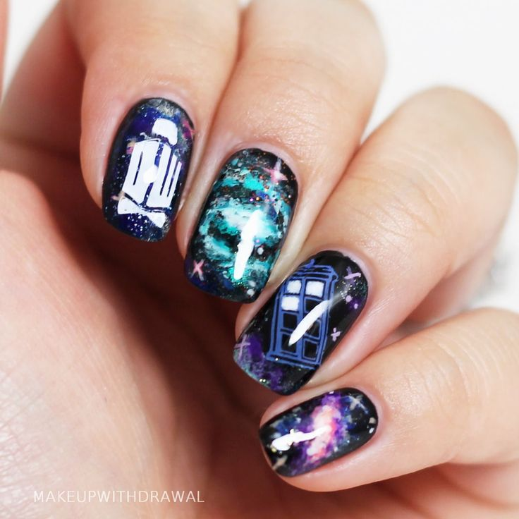 It's a combination of hand painted nail art and stamped images. The Tardis and the DW logo (complete with a fez and bowtie!) are from this awesome plate my friend showed me.