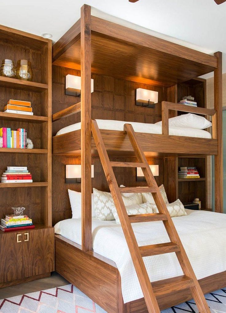 wood adult bunk beds with white bedding