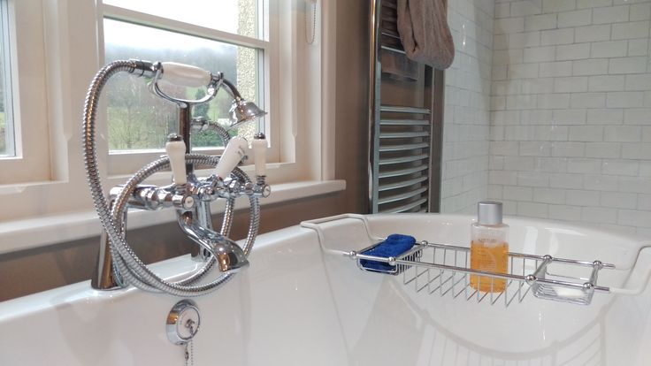 Roll top bath (from Bathstore) with taps and shower mixer from Victorian plumbing. Porcelain plug from Bristan.