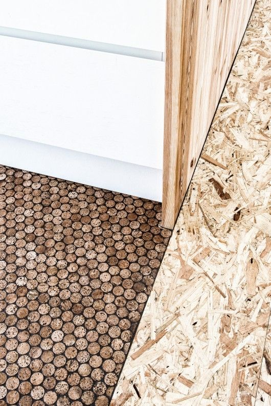 Upcycled kitchen floor made of champagne cork leftovers | photo © Jesper Ray