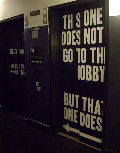 Interior Painted Signage (Restroom Doors?)