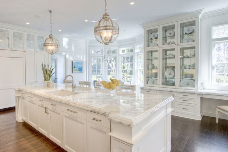 Kitchen featuring Restoration Hardware Victoria Hotel Pendants and built in hutch