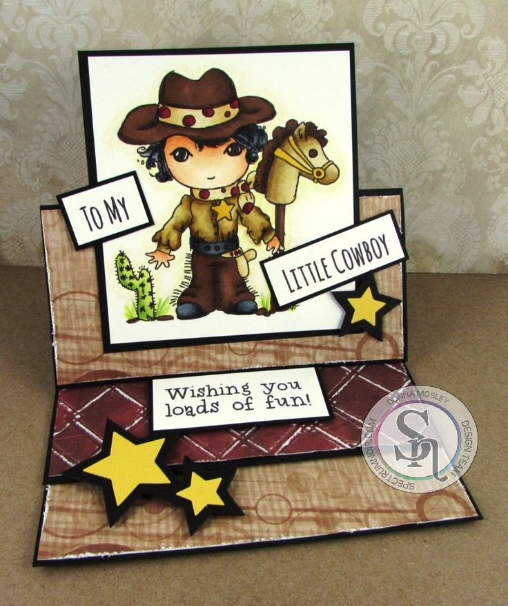 Designed by Donna Mosley Easel card made using Scruffy Little Kitten Billie stamp set Sara Signature Just For Men collection Spectrum Noir Pens & Pencils Skin -TN2 FS3 FS1/Saddle Brown Scarf EB2 EB1/Yellow Ochre - Spots DR7 DR6 Shirt - GB10 EB2 EB1/Yellow Ochre & Bark Hat & Trousers - EB5 EB3/Bark Cactus - CG3 CG1/Cactus & Fern Green Star GB4/Maize Hair & Shoes IG10 IG8 IG8 IG5/Black #spectrumnoir #crafterscompanion #craft #scruffylittlecat #cowboy