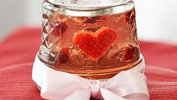 These rosé wine jelly shots are flipped upside down with floating fruit in heart-warming snow-globe style.