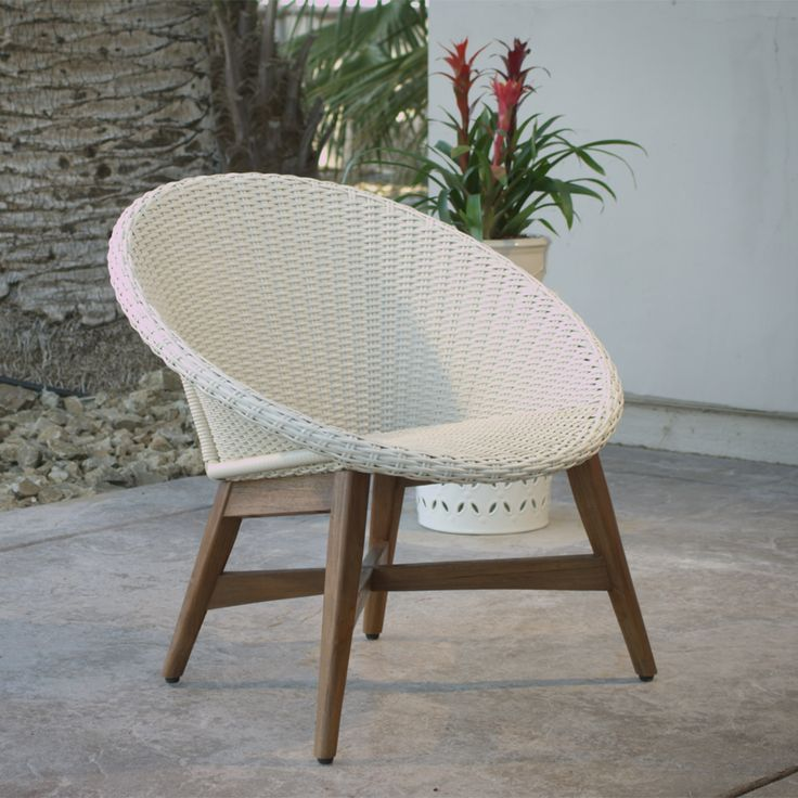 Bring a casual, mid-century vibe to your outdoor area with our cozy chair featuring an antique white all-weather wicker seat and teak wood legs for intriguing contrast.