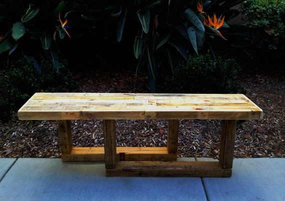 Distressed entry-way bench: Rugged Style Handmade Pallet Wood Bench with a Mix of Natural Colors. Awesome piece.