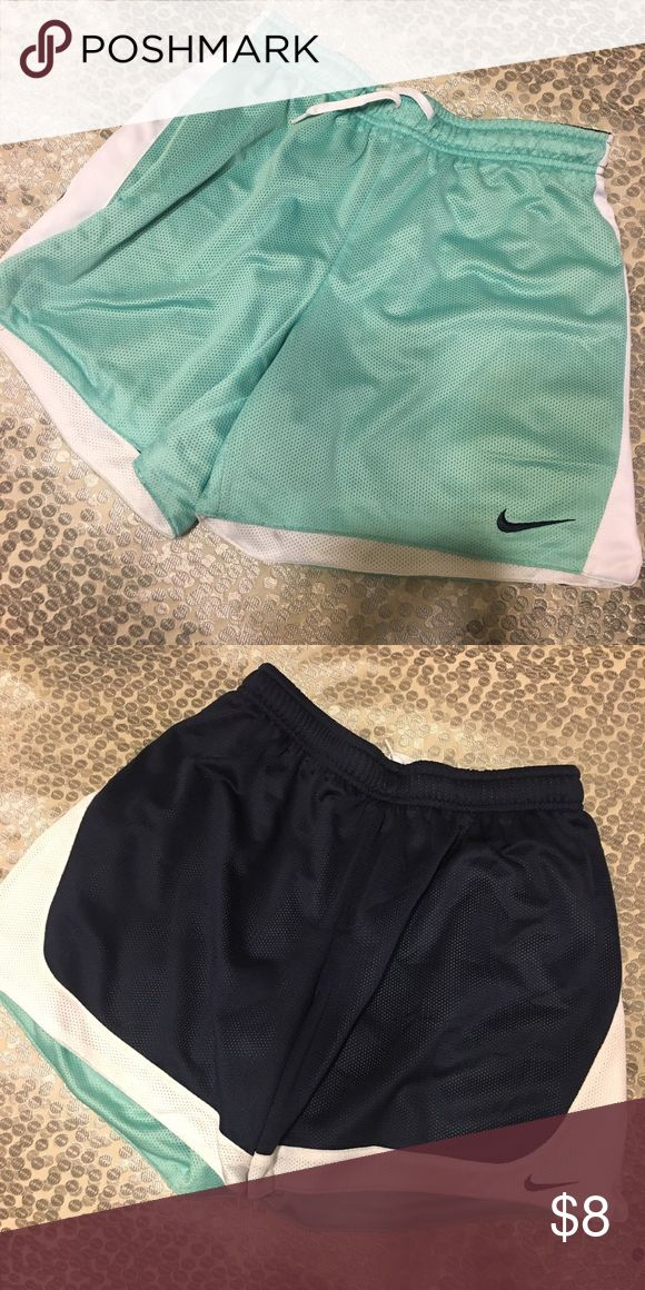 "Women's Nike Tiffany Blue Athletic Shorts Women's Nike Tiffany Blue Athletic Shorts • REVERSIBLE to navy blue • drawstring • length is about mid thigh when not rolled on me (5'5"") • no tears or stains Nike Shorts"