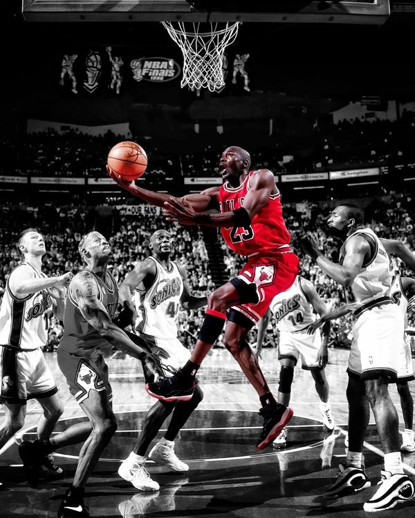 This iconic photo art piece captures the Chicago Bulls Michael Jordan executing a reverse layup against the Seattle SuperSonics during game 4 of the 1996 NBA Finals at Key Arena, as Dennis Rodman and Shawn Kemp look on.