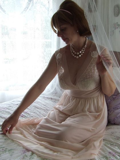 mature woman in nightgown