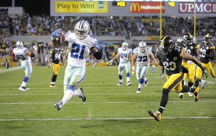 Cowboys vs. Steelers  - 35-30, Cowboys  -  November 13, 2016:  Dallas Cowboys running back Ezekiel Elliott (21) scores a fourth quarter touchdown in front of Pittsburgh Steelers free safety Mike Mitchell (23). Max Faulkner mfaulkner@star-telegram.com