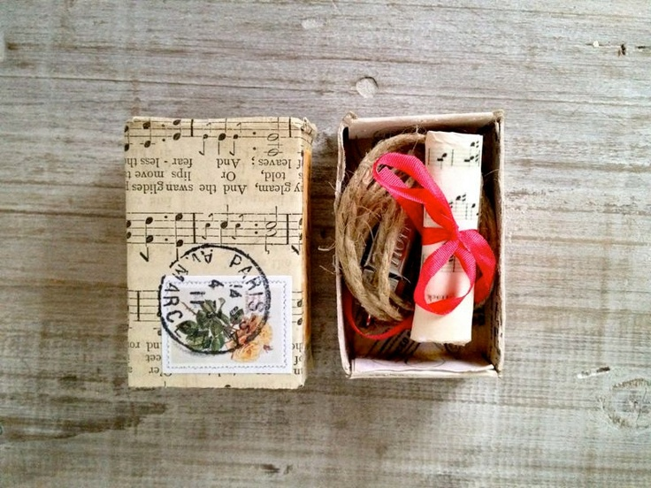 Altered vintage matchbox with a music theme inside