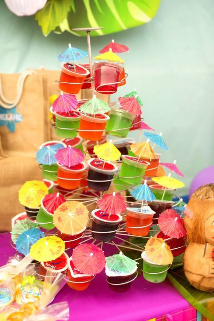 Hawaiian Luau Birthday Party umbrella topped cupcakes!  See more party ideas at CatchMyParty.com!
