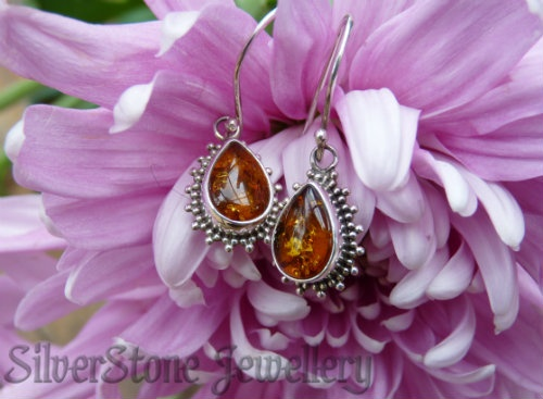 silver amber earrings with filigree detailed frame hook style, $49 - available online www.silverstonejewellery.co.nz