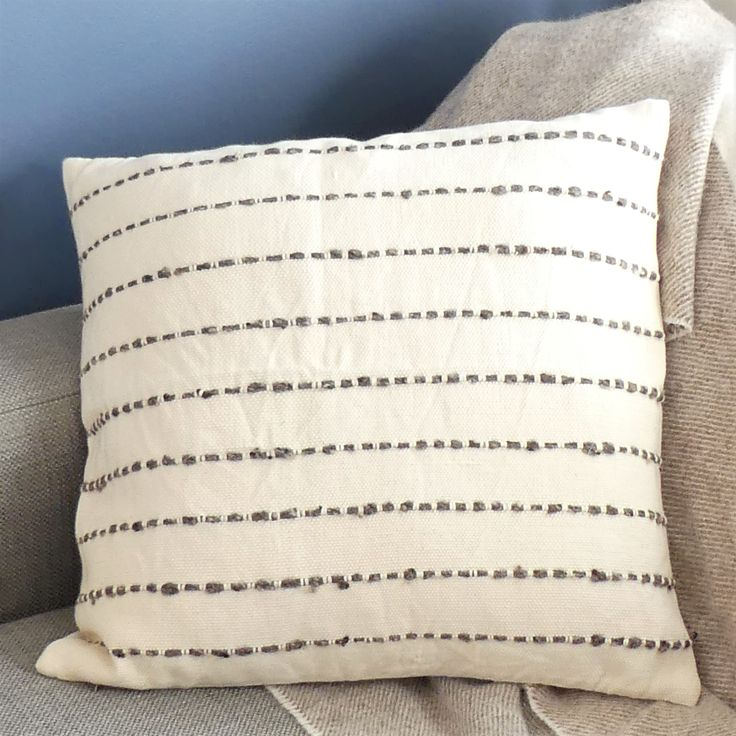 Exquisitely textured and timelessly stylish, the hand-woven Rio Cushion Cover will add understated style to any interior. Natural un-dyed cotton pairs with the finest wool. Hand-woven in Guatemala on a backstrap loom.  Handcrafted with skillful hands and careful attention, each piece has unique qualities in natural texture, softness, and colour.