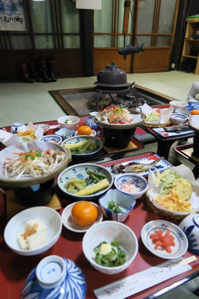 Dining around the Irori Hearth at Nodaniya Ryokan Inn at Shirakawa-go, Japan