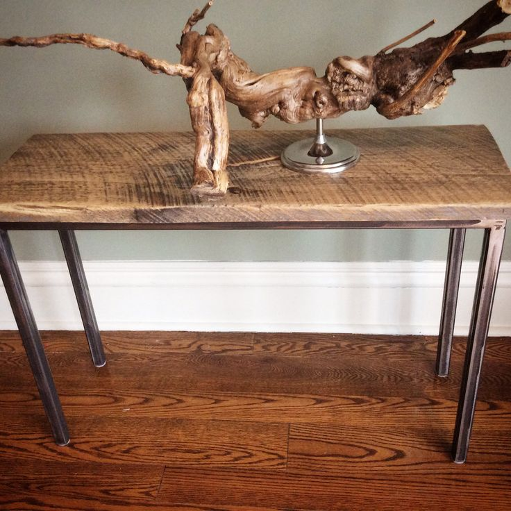 Salvaged Wood combined with unpainted steel legs for a modern console table or narrow side table.