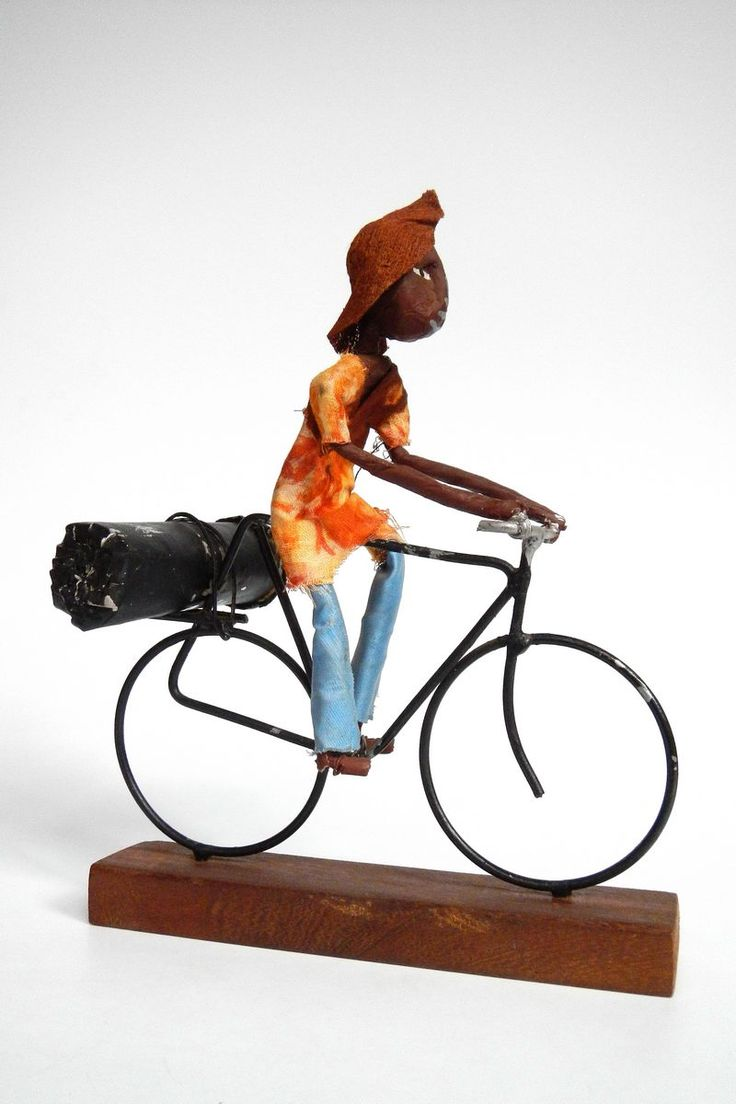 Uganda | Doll riding bicycle. Marked Craft Box, Buganda Road on the bag it came in.
